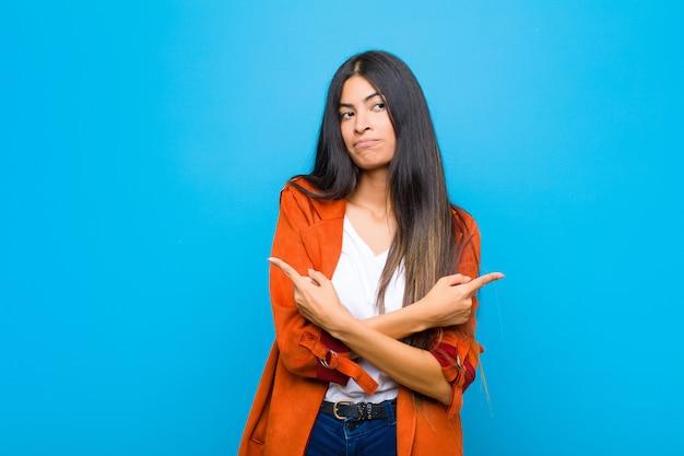 Parecendo confuso e confuso, inseguro e apontando em direções opostas com dúvidas
