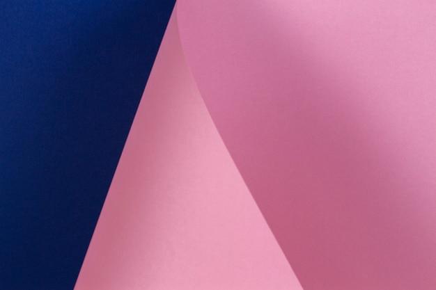 Parede abstrata com textura de papel rosa pastel e azul