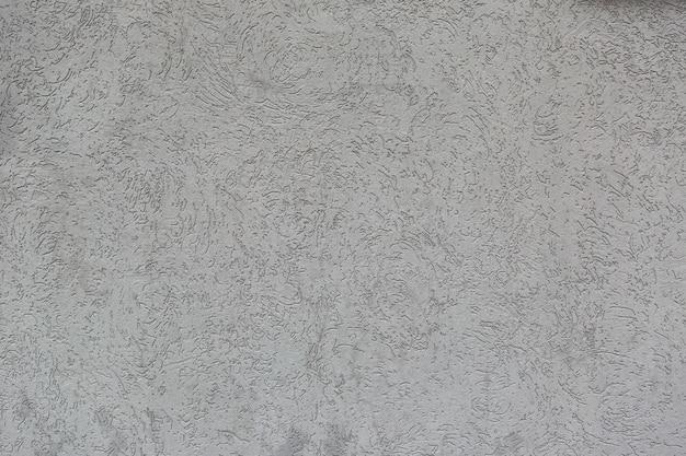 Parede acabada com reboco de fundo e pronta para pintura em construção. parede cinza.