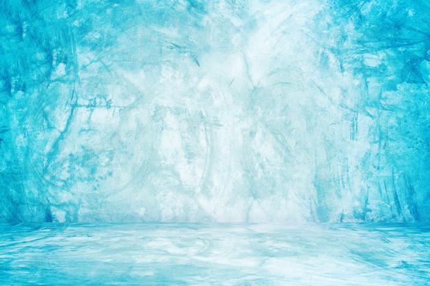 Parede azul do estúdio do cimento e do fundo da sala de exposições para o produto da apresentação