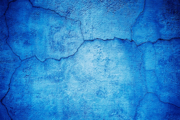 Parede azul, textura de fundo de rua de cimento colorido
