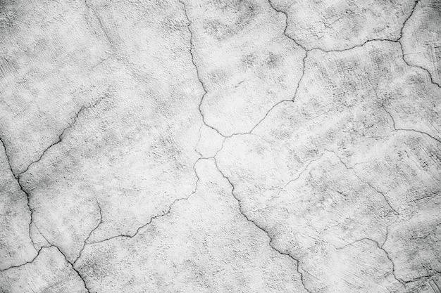 Parede branca, a superfície de gesso rachado, textura de concreto