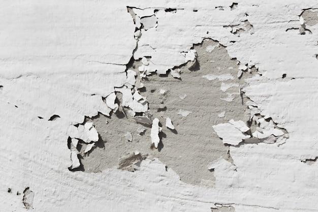 Parede cinza com pintura cinza descascada parede de concreto cinza gasto velho com danos severos superfície áspera tex ...