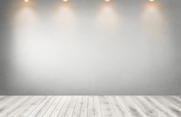 Parede cinza com uma linha de holofotes em um quarto vazio