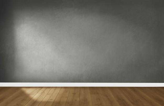 Parede cinza em um quarto vazio com um piso de madeira