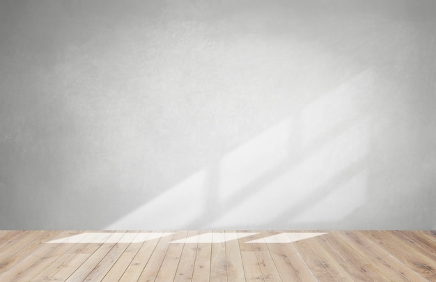 Parede cinza em uma sala vazia com piso de madeira