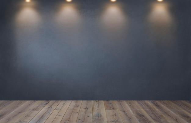 Parede cinza escuro com uma fileira de holofotes em uma sala vazia