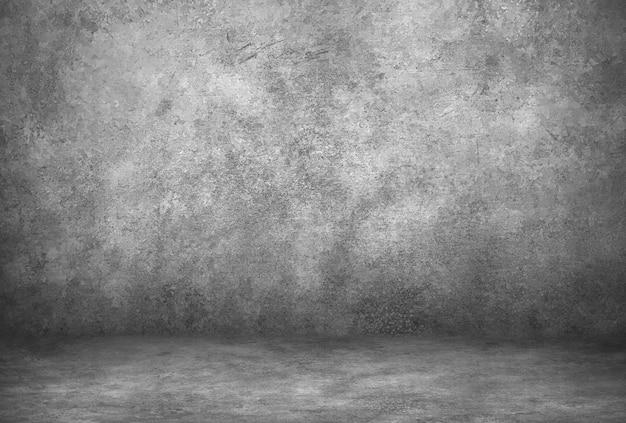 Parede cinzenta do cimento e sala do estúdio com fundo. exibição do produto em branco.