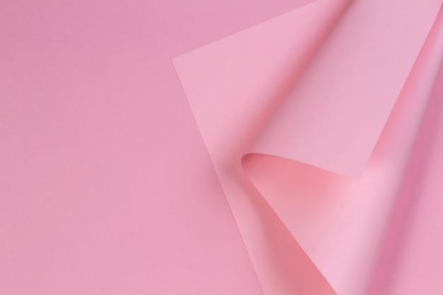 Parede colorida abstrata. papel rosa pastel em forma geométrica