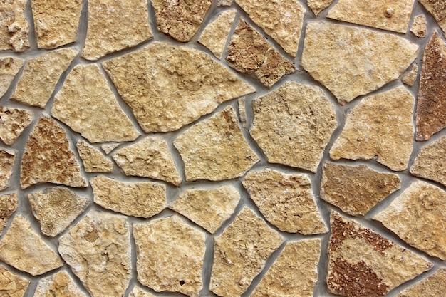 Parede com acabamento em pedra natural. textura, plano de fundo.