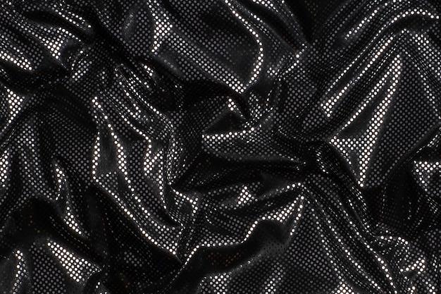 Parede com textura de tecido de bolinhas prateado metálico preto cinza.