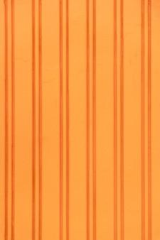 Parede de aço laranja abstrata