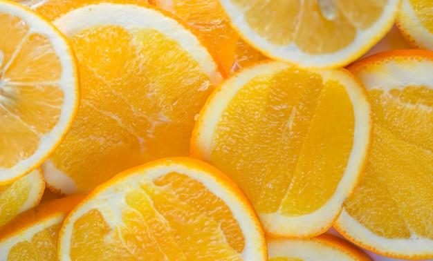 Parede de alimentos frescos fatias de laranja picada, cor laranja fresca para uso em fazer a parede,