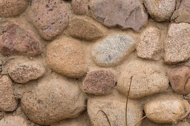 Parede de alvenaria. pedras. textura. superfície