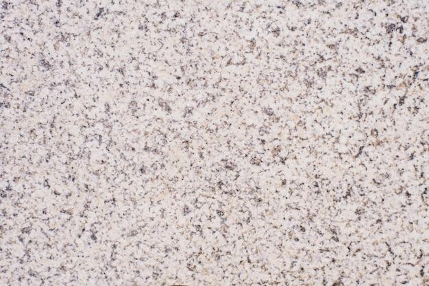 Parede de azulejo de granito cinza com grão