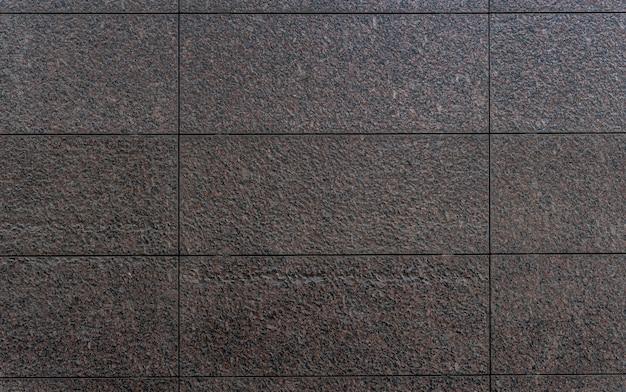 Parede de azulejos escuros de vista frontal