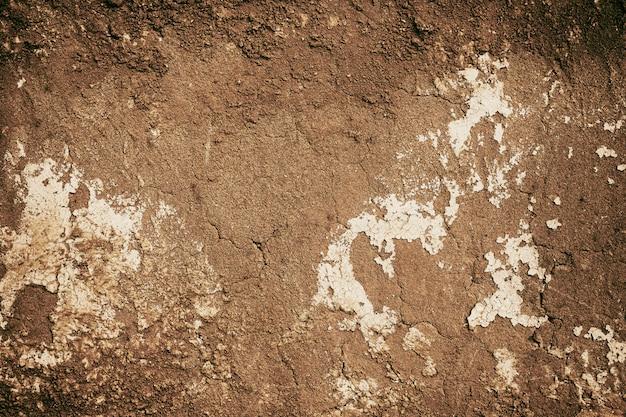 Parede de casa rachada textura solo para fundo natural velho