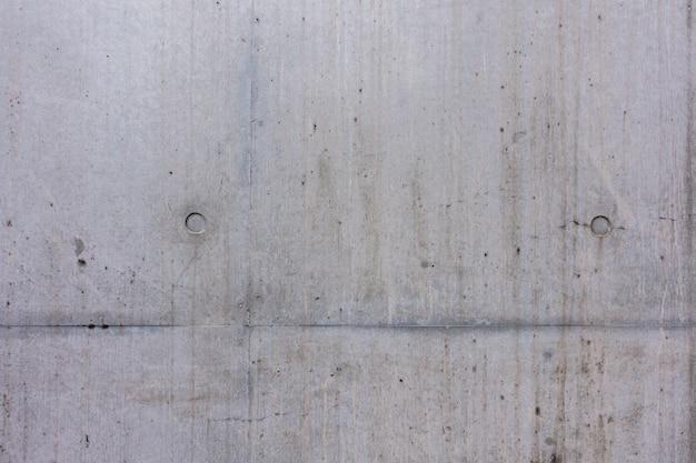 Parede de cimento cinza com linha de arranhões para fundo de textura