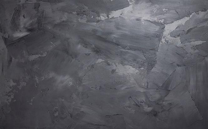 Parede de cimento cinza com textura de estuque, espaço concreto