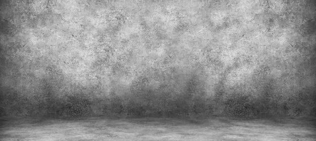 Parede de cimento cinza e sala de estúdio