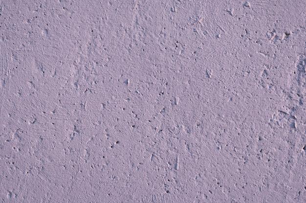 Parede de cimento com rugosidade, fissuras e solavancos. fundo abstrato do grunge.