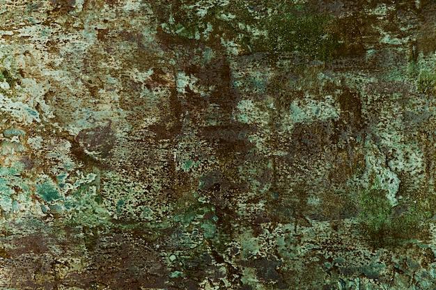 Parede de cimento com superfície rugosa e tinta