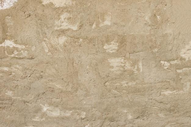 Parede de cimento de concreto grunge com rachadura em fundo de construção, design e textura industrial.