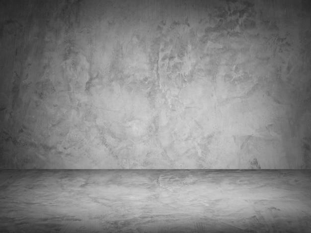 Parede de cimento escuro e fundo de estúdio