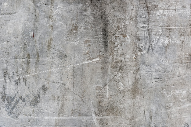 Parede de cimento velho com riscos