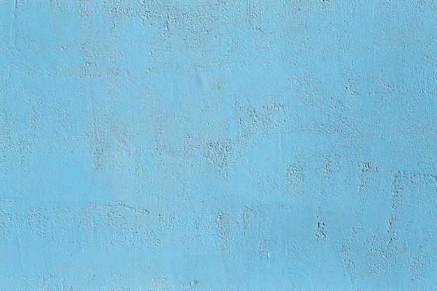 Parede de concreto azul com gesso e textura de pedra