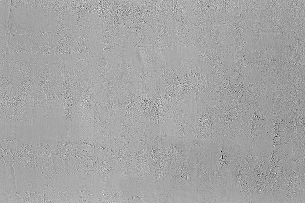 Parede de concreto cinza com gesso e textura de pedra