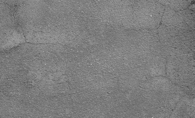 Parede de concreto cinza com textura lisa, pele rachada