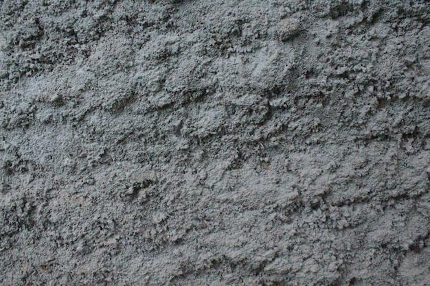 Parede de concreto com fundo de cimento cinza claro