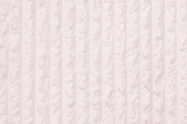 Parede de concreto listrado rosa pastel texturizada