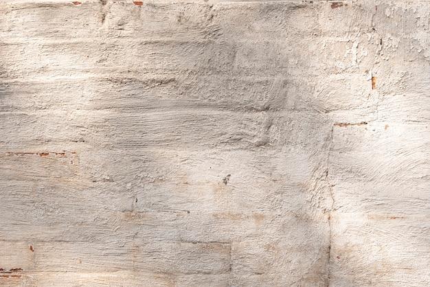 Parede de construção envelhecida feita de tijolos