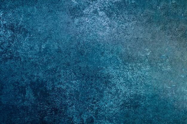 Parede de cor azul do grunge, pintura abstrata de cor azul. grunge projetado na textura da parede