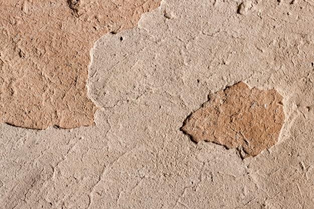 Parede de espiga velha com superfície rachada