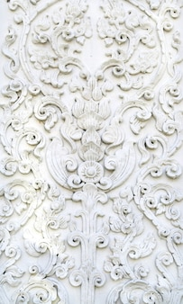 Parede de estuque branco arte tailandesa, templo