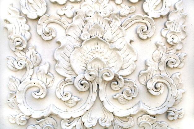 Parede de estuque de arte tailandês branco, templo tailandês