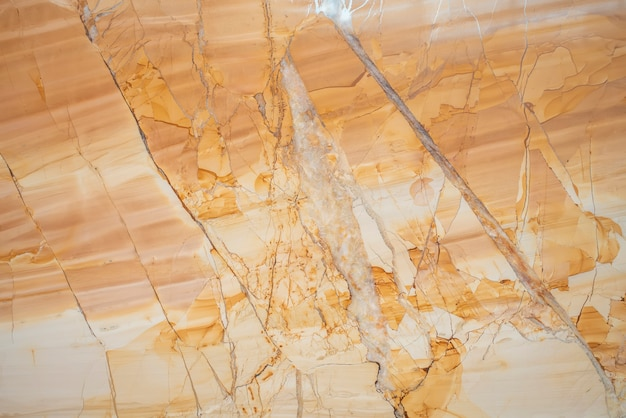 Parede de fundo de laje de mármore bege