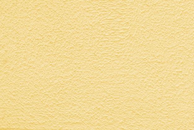 Parede de gesso amarelo de um edifício. textura de superfície áspera.