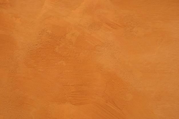 Parede de gesso vermelho de cimento tem concreto de superfície áspera
