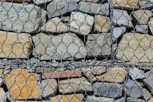 Parede de grade e pedras de textura