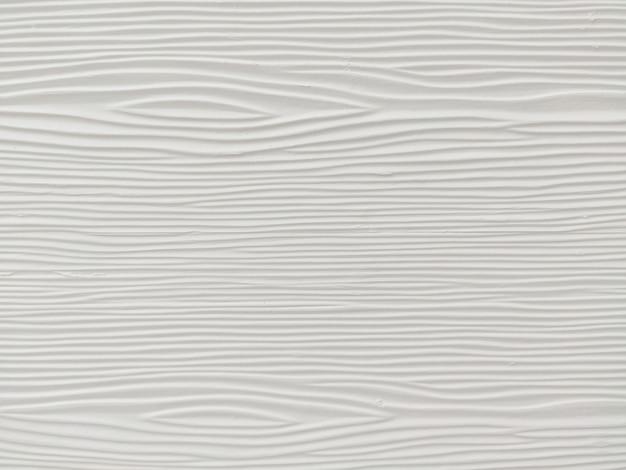 Parede de madeira branca com padrão abstrato