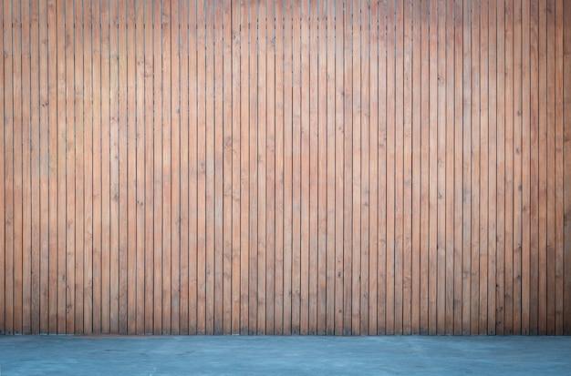 Parede de madeira com fundo de piso de concreto para design de interiores, painel de madeira