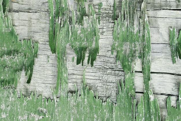Parede de madeira com pintura descascada. pinte paredes de gesso descascado. antigo fundo rústico pintado de madeira, pintura descascando
