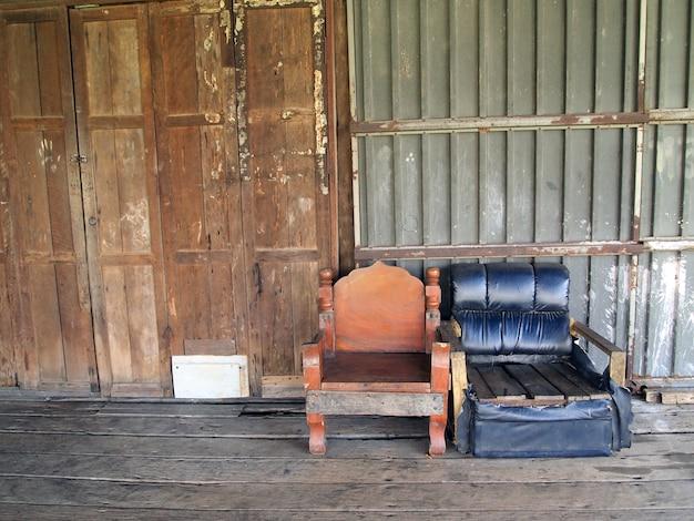 Parede de madeira da antiga casa tailandesa