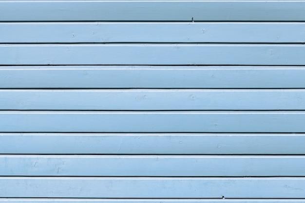 Parede de madeira pintada com tinta azul