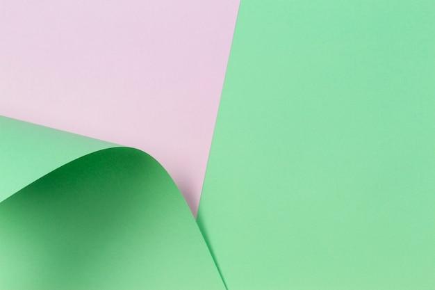 Parede de papel de cor verde e branca de forma geométrica abstrata