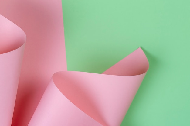 Parede de papel de cor verde e rosa pastel de forma geométrica abstrata